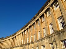 Royal Crescent Bath England Georgian architecture. Georgian terraced townhouses of the Royal Crescent create a gracious curve beneath a blue sky Royalty Free Stock Images