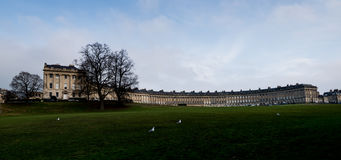The Royal Crescent in Bath, Somerset, England. The Royal Crescent is a row of 30 terraced houses laid out in a sweeping crescent in the city of Bath, England Royalty Free Stock Photo