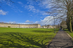 Royal Crescent and Royal Victoria Park in Bath. A view of the Royal Crescent from a pathway in Royal Victoria Park in Bath, Somerset Stock Photography