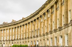 Royal Crescent with Stone Ionic Columns. The Royal Crescent is a row of 30 historic Georgian town homes in the city of Bath, England Stock Photos
