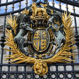 Royal Crest. The Royal Crest on the gates of Buckingham Palace, London UK Stock Images