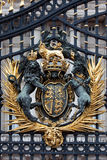 Royal Crest at Buckingham Palace Gate. In London, United Kingdom royalty free stock photos