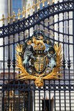 Royal Crest at Buckingham Palace Gate in London Stock Image