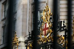 Royal crest in the streets of London. Royal crest with England`s flag on it and golden details Royalty Free Stock Image