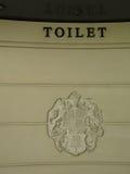 Royal crest on toilet Royalty Free Stock Photo