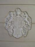 Royal crest on toilet Stock Photo