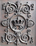 Royal crown 2. Royal crown on the old doors Stock Photo