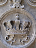 Royal crown. On the old doors Royalty Free Stock Image
