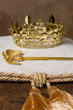 Royal crown on cushion. Royal scepter and golden crown on a cream cushion stock photo