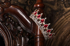Royal crown with red gems. Ruby, garnet. Symbol of power and authority Royalty Free Stock Photography