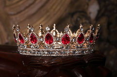 Royal crown with red gems. Ruby, garnet. Symbol of power and authority Stock Photo