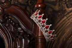 Royal crown with red gems. Ruby, garnet. Symbol of power and authority. Royal crown with red gems. Ruby, garnet stock image