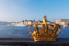 Royal crown and Stockholm cityscape Stock Images