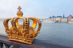 Royal crown and Stockholm cityscape Stock Image