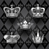 Royal crowns set in black and white colors on retro background. Vintage design elements. There is in addition a vector format EPS 10 Royalty Free Stock Photos