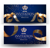 Royal design banners with gold curly silk ribbons and blue background. Stock Photo