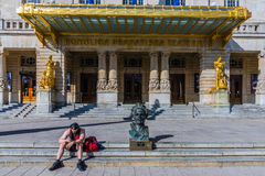 Royal Dramatic Theater. Unidentified passerby sits by the August Strindberg bust in front of the Royal Dramatic Theater. The theatre is located in the Art Stock Photos