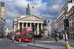 The Royal Echnage building with moving red double decker buses Royalty Free Stock Photography