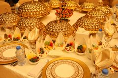 Royal elegance wedding reception table with different cookery food arrangement . Royal elegance wedding reception table with different cookery food arrangement royalty free stock photography