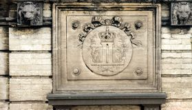 The Royal emblem of the Brussles Palace on the wall in belgium. Europe with 2 lion faces stock photo