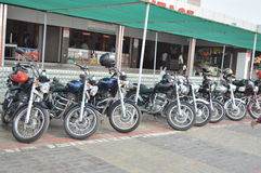 Royal Enfield bikers group at hotel. Indian famous Royal Enfield bikes parked near hotel. Bikers group vising different places on their bikes Stock Photos