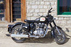 Royal Enfield motorcycle, Bhutan. Royal Enfield motorcycle at the Chhume village, Bhutan. Royal Enfield was the brand name under which the Enfield Cycle Company Stock Photo