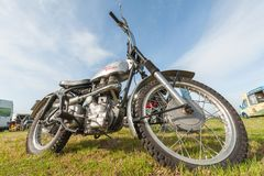 Royal Enfield motorcycle. Dunsfold, UK - August 26, 2017: Wide-angle closeup of a vintage Royal Enfield off-road motorcycle at a gathering of classic and modern Stock Image