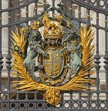 Royal family crest. The Royal Crest on the gates of Buckingham Palace in London - UK stock photos
