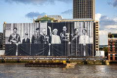 The Royal Family London UK. Huge old picture of the Royal Family instaled on Thames River for the london olympic 2012 Stock Photos