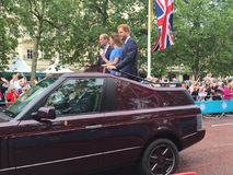 Royal family Windsor. Prince harry kate and will in an open top Range Rover driving down the mall waiving at crowds. Duke and duchess of Cambridge Stock Photo