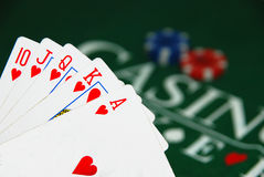 Royal flash. On green felt and casino chips Stock Image