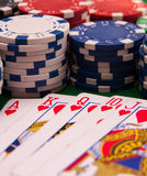 Royal flash. Poker gamble cards on green casino table with chips Stock Photography
