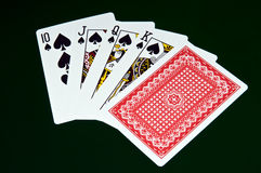 Royal flash - cards on green background Royalty Free Stock Photography