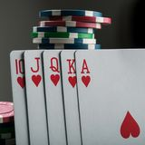 Royal flash on cards and poker chips Royalty Free Stock Images