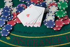 Royal flash on cards and poker chips Stock Photos