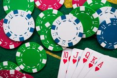 Royal flash on cards and poker chips Royalty Free Stock Image