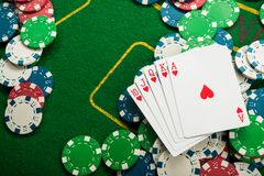 Royal flash on cards and poker chips. On green casino table. success in gambling Stock Photography