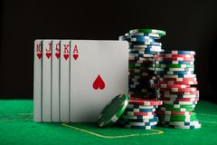 Royal flash on cards and poker chips Royalty Free Stock Photos