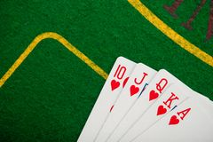 Royal flash on cards and poker chips Stock Photography