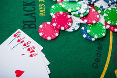 Royal flash on cards and poker chips. On green casino table. success in gambling Royalty Free Stock Images