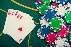 Royal flash on cards and poker chips. On green casino table. success in gambling Royalty Free Stock Photos