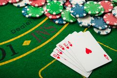 Royal flash on cards and poker chips. On green casino table. success in gambling Stock Image