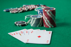 Royal Flash On The Green Background. Royal Flash With Colourful Casino Chips On Green Background Stock Photography