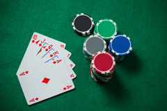 Royal Flash On The Green Background. Royal Flash And Colourful Casino Chips On The Green Background Stock Photos