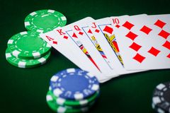 Royal flash and poker chips on green casino table. gambling success Stock Photo