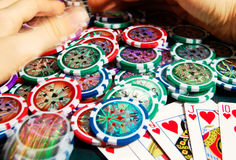 Royal flash win in poker and female hands grabbing bank. Blurred motion. Royalty Free Stock Photos