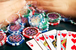 Royal flash win in poker and female hands grabbing bank. Blurred motion. Stock Photo