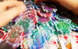 Royal flash win in poker and female hands grabbing bank. Blurred motion. Stock Images