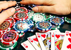 Royal flash win in poker and female hands grabbing bank Stock Photo