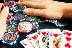 Royal flash win in poker and female hands grabbing bank Stock Image